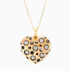Stunning matt gold heart pendant is handcrafted in 18k yellow gold with brilliant round cut diamonds with a total weight 0.61ct. A bold, modern setting transform a diamond pendant into an unusual and striking work of art.