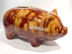 ITEM #041707  This is a yellow ware / spongeware pottery pig piggy bank marked USA. Per  Collectors Guide to Yellow Ware (Books 1, 2 and 3), this pig piggy bank was made in Ohio circa 1915-1920 and was made in two sizes, 3 and 6. This one is the 6.  Condition: Very good antique-vintage condition with typical wear due to age and handling. Typical crazing seen upon close inspection as should be consistent with age.  To find more great antique and vintage items, please visit my shop at: htt...