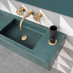 Solid concrete bathroom sink in forest green from Aston Matthews