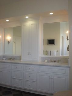 Cabinets, recessed lighting with wall sconces