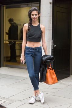 Looking for the black crop top, blue jeans and white sneakers that Sara Sampaio is wearing - 39108 - SeenIt Sara Sampaio, Models Off Duty, Fashion Models, Fashion Outfits, Vestidos Sexy, Model Street Style, Mannequins, Dress To Impress, Style Me