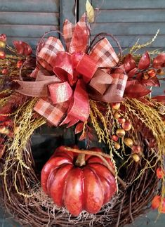 This Autumn wreath features Chinese lanterns, seed pods, bright green grasses and, of course a pumpkin! It was created on an 18 grapevine wreath base and the finished size is 26 x 25 x 8 deep. If displaying your wreath outside, please find an area that is protected from the