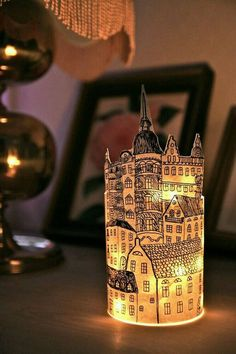 Even paper cities need light! You can recreate this adorable craft with battery-operated string lights.