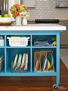 Stand-alone tables or cabinets easily become a cost-friendly feature for an island-less kitchen. Just add rolling casters so you can move the piece at will. The more extras you add -- say, a cabinet with drawers -- the more it will cost, so if a super-low budget is the goal, go for a simple table.
