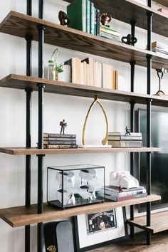 Brass wishbones, shirt collars, and telephones line these perfect shelves.