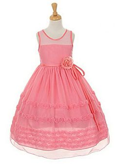 Girls Dress Style 6359- Sleeveless Poly Mesh Dress with Rosette Skirt in Choice of Color  This darling style will be all the rave once your little one enters the room in this pretty poly mesh dress. The sleeveless style features an illusion neckline and a bodice accented by the cutest three dimensional flower.  http://www.flowergirldressforless.com/mm5/merchant.mvc?Screen=PROD&Product_Code=KK_6359CO&Store_Code=Flower-Girl&Category_Code=Coral_Peaches_Orange