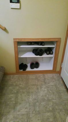 recessed split level shoe storage shelf built in to wall to provide shoe storage for small split entry using inch plywood and channel lock shelving