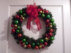 This beautiful wreath is handmade with traditional red, green and gold shatter-proof Christmas ornaments. Atop of wreath is a red wired ribbon bow.   www.etsy.com/listing/117603305/santas-favorite-christmas-wreath