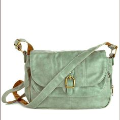 Green or teal purse / bag with many pockets used for only about 4 months. in perfect condition!!! amazing for trips to the city or Disneyland  literally has an incredible amount of pockets. firm price. ModCloth Bags Crossbody Bags