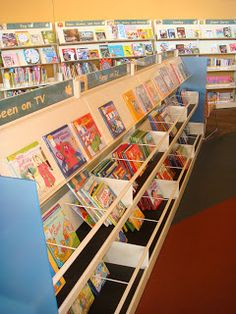 Kid-level, face-out shelving for picture books.  Definitely board books!