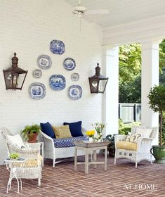 I love how the plates are used to decorate the outside wall on the veranda. Blue and white is always one of my favorite color schemes! Outdoor Spaces, Outdoor Living, Outdoor Decor, Outdoor Ideas, Wicker Furniture, Outdoor Furniture Sets, Rattan Sofa, Porches, Summer Porch