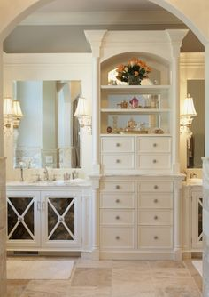 Love The Storage Between The Double Sinks great use of space and wonderful storage