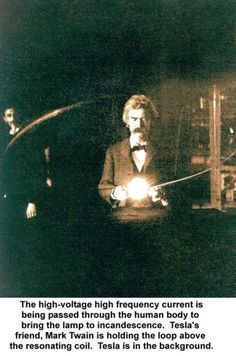 Mark Twain & Nikola Tesla The high-voltage frequency currect is being passed through the human body to bring the lamp to incandescence.  Tesla's friend, Mark Twain is holding the loop above the resonating coil.  Tesla is in the background.