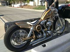 Shovelhead swingarm custom with white solo seat, rear fender cropped in line with fender struts and gold paint