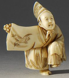 "IVORY NETSUKE Depicting a Sambaso dancer in a crane-decorated costume. Signed ""Masatsugu"". 