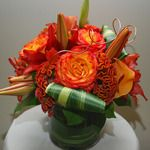 Burnt orange lilies, roses, and cockscomb