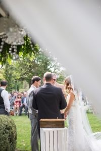 The ceremony from behind the drapery
