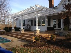 Custom Vinyl Pergola with automatic sunshade and stone columns Vinyl Pergola, Pergola Kits, Porch Wood, Stone Columns, Privacy Walls, Pergola Lighting, Outdoor Living, Outdoor Decor, Pergola Shade