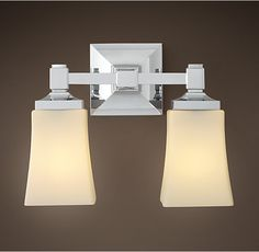 """Dillon Double Sconce from Restoration Hardware.  Available in Satin Nickel, Oil-Rubbed Bronze, Polished Chrome, and Polished Nickel.  Overall: 11½""""W x 7""""D x 9½""""H. 3.75"""" square backplate."""