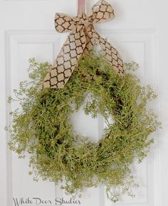 Simple in design, yet stunning in appearance, this gorgeous greenery wreath is a welcome addition to any homes decor.  Display indoors or on