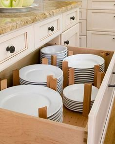 I know everyone usually stores their dishes on shelves on in cabinets but drawers also seem to be a great idea. This system is actually very nice and you can install these dividers and customize the drawer however you want. Kitchen Makeover - 28 Kitchen Amenities You'll Wish You Already Had