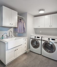 Trim Kitchen transitional laundry room. Shaker simplicity AND my farmhouse sink! I might be inclined to go with a red washer/dryer.