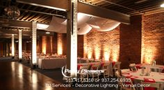 Uplights on pillars and brick wall highlight the features of this venue. Picture taken at Longworth Hall. $25 per light. Contact us for discount package and pricing options.