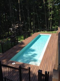 Contemporary Swimming pool with Fiberon composite decking. Fiberon is a great building material to use around pools because it will never splinter like wood does. Your feet will thank you! #pooldeck
