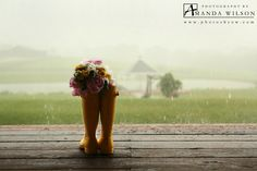 Rainy wedding day, bride with rain boots, yellow rain boots,  ©Copyright 2014 Photography by Amanda Wilson www.photosbyaw.com