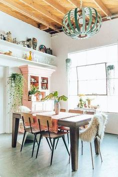boho interior design dining room with natural light || And that light fixture!