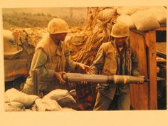 Pfcs Bunch and Peterson of H & S Company, 1st Battalion, 26th Marines handle 106 MM recoiless rifle ammo on the Bravo Company perimeter. 22February68. Photo courtesy of the National Archives. BRAVO! COMMON MEN, UNCOMMON VALOR @ https://bravotheproject.com/. #BRAVO! #USMC #KheSanh #VietnamWar #NARA
