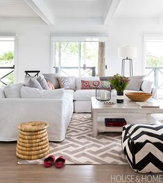 The playful mix of patterns and abundance of cushions means it can be mussed up or moved around without looking undone. | Designer:  Lloyd Ralphs Design Photo: Donna Griffith