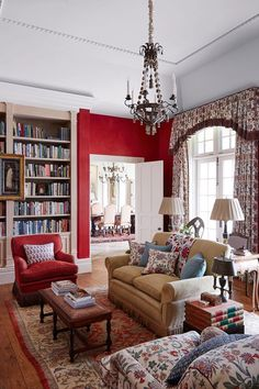 See all our stylish living room design ideas on HOUSE by House & Garden, including this seating area with red walls.