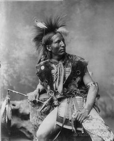 Sioux Native American ceremonial dance costume taken around 1899. Enlarged: http://www.ancientfaces.com/photo/sioux-ceremonial-dance-costume/1171870