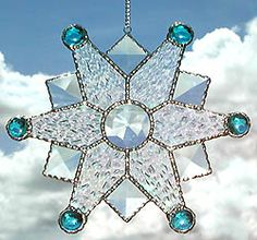 Sparkling snowflakesuncatcher, handcrafted with beautiful clear bevels. The pieceis wonderful in your home or as a Christmas gift. - Christmas Gift Idea -  More Handcrafted stained glass designs can be found at www.AccentonGlass.com