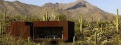 Rusty three steel cubes to a desert home page #Architecture #interior