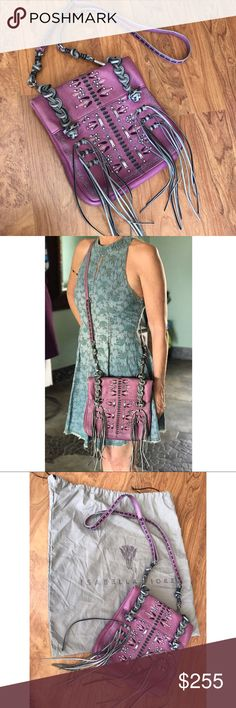 🎉HP🎉 Isabella Fiore Fringe Benefits Crossbody Beautiful fun cross-body with intricate embellishments with both silver and leather. Used just once or twice, was just too small for all the junk I carry. Completely clean interior, one pocket & one zipper area inside as well as a convenient outside pocket for quick phone storage & access. Dust bag included. Isabella Fiore Bags Crossbody Bags