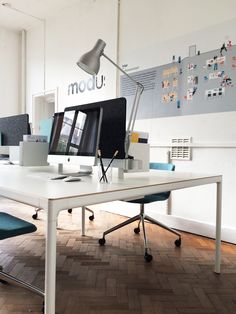 A close up of the Edge Desk by @pearsonlloyd featuring @anglepoise type 75