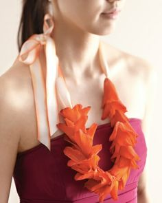 Isle Style - Nod to tropical traditions by swapping the usual clutch of flowers for a lei-style necklace. Just string bright gladiolus blossoms onto fishing line and add a colorful ribbon closure.