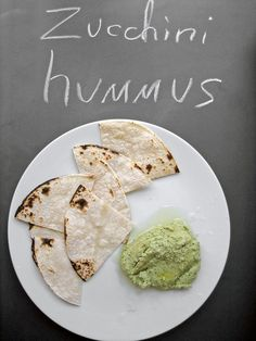 Zucchini Hummus   1 (15-oz) can chickpeas, drained and rinsed  1 cup coarsely chopped zucchini  1 garlic clove, chopped  1/4 cup chopped fresh parsley  1/4 cup chopped fresh basil  1/2 teaspoon salt  1/4 teaspoon ground black pepper  1/4 cup extra-virgin olive oil  1 teaspoon fresh lemon juice