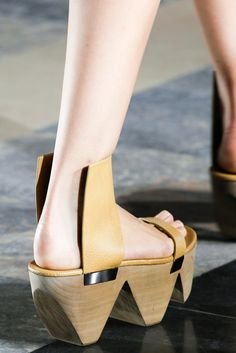 Why wouldn't women want to carry around all this extra wood weight?  After all, aren't we all masochists?  No?  [Spring 2015 Ready-to-Wear - Rick Owens]