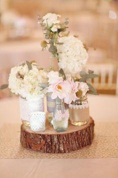 mismatched vases on wood stump
