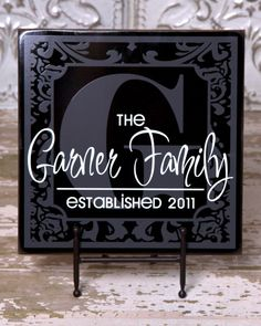 Home decor-black tile, etched vinyl and then a solid color overlayed family name.....very pretty!!!