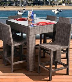 """This bar set from our """"Atlantic"""" collection is both elegant and contemporary. With a table big enough to accommodate 6 people and incredibly comfortable chairs, this set would make an impact whether you use it outdoors or indoors."""