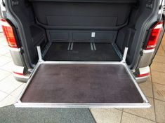 Reardrawer for California Beach with multiflexboard This rear drawer was designed for the California Beach with multiflexboard. It is a modular kit of aluminum . Vw Beach, Guide System, Boot Storage, Vw T5, Side Wall, California Beach, Galvanized Metal, Back Seat, Vw Camper