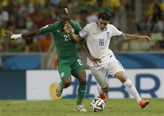 Ivory Coast's Serey Die, left, and Greece's Lazaros Christodoulopoulos challenge for the ball during the group C World Cup soccer match between Greece and Ivory Coast at the Arena Castelao in Fortaleza, Brazil, Tuesday, June 24, 2014. (AP Photo/Natacha Pisarenko) ▼24Jun2014AP|Greece scores late to advance at World Cup http://bigstory.ap.org/article/drogba-starts-ivory-coast-against-greece #Greece_Ivory_Coast_group_C #Brazil2014