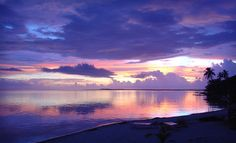 Sunset over the ocean at the Isla Marison in Belize.