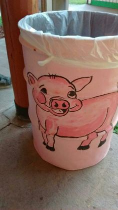 Painted pig trash can