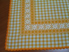 Cross-stitch on checked fabric. Great for a tablecloth, napkin, pillowcase, etc.