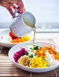 Vegan Sunshine Bowl w/ fresh crunchy veggies- grated beets, carrots, kohlrabi, sunchokes, radish & jicama with nutty brown rice and sunflower tahini sauce. | www.feastingathome.com